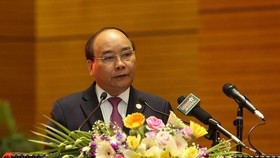 Prime Minister Nguyen Xuan Phuc will clarify issues within the Government's remit on the last day of the Q&A session on November 1 (Photo: VNA)