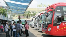 Passengers at a coach station in HCMC