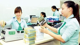 Overseas remittances is forecast to reach US$15.9 billion this year (Photo: SGGP)