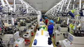 A production line in the Jasan Textile and Dyeing Vietnam in VSIP Hai Phong, which is invested by China (Photo: VNA)