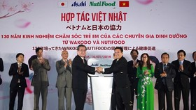 Nutifood and Japanese beverage producer Asahi set joint venture to produce nutritional products for Vietnamese children. (Photo: SGGP)