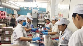 The sausage production line at Vissan Company (Photo: SGGP)
