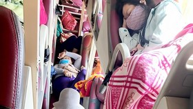 Passengers in a coach from Ninh Thuan to HCMC (Photo: SGGP)