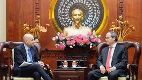 Secretary of HCMC Party Committee Nguyen Thien Nha receives Italian Ambassador to Vietnam Antonio Alessandro on March 15 (Photo: hcmcpv)