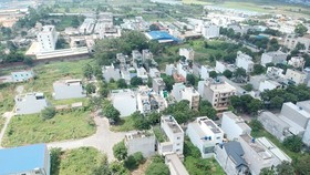 Tan Nhut commune Residential area and Mall. (Photo: SGGP)