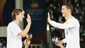 Modric muốn theo chân Ronaldo là chuyện không có gì khó hiểu. Ảnh: Getty Images
