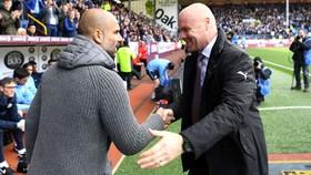 HLV Sean Dyche (phải) cảm nhận rõ quyết tâm chiến thắng bằng mọi giá của Pep Guardiola. Ảnh: Getty Images