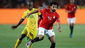 Mohamed Salah (phải) không thành công cùng tuyển Ai Cập nên sẽ trở lại sớm. Ảnh: Getty Images