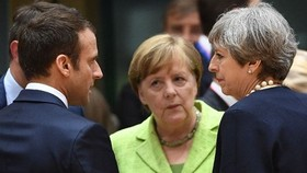 Từ trái qua: Tổng thống Pháp, Thủ tướng Đức và Thủ tướng Anh muốn bảo vệ thỏa thuận hạt nhân Iran. Ảnh: AP
