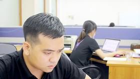 Nguyễn Xuân Bằng tại văn phòng làm việc