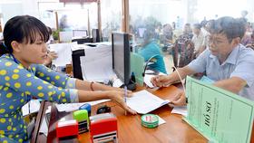 Với cơ chế, chính sách đặc thù, cán bộ, công chức ở TPHCM hoàn thành tốt nhiệm vụ sẽ được hưởng mức thu nhập tăng thêm gắn với năng suất, hiệu quả công việc. Ảnh: VIỆT DŨNG