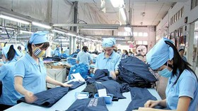 Lao động dệt may Việt Nam đang đứng trước thách thức lớn của cuộc cách mạng công nghiệp 4.0. Ảnh: MỸ HẠNH