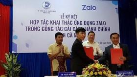 Lễ ký kết hợp tác khai thác ứng dụng Zalo - Ảnh: Hàm Yên