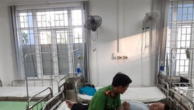 Công an lấy lời khai từ PV Trương Ngọc Minh tại bệnh viện