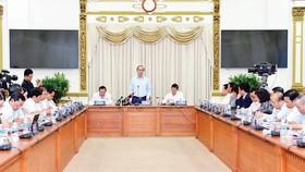 Bí thư Thành ủy TPHCM Nguyễn Thiện Nhân phát biểu tại buổi sơ kết. Ảnh: Việt Dũng