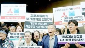 Người dân Hàn Quốc kêu gọi tẩy chay hàng hóa Nhật Bản. Ảnh: EPA
