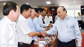 Thủ tướng Nguyễn Xuân Phúc với các đại biểu. Ảnh: TTXVN
