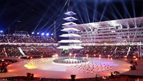 A tower is illuminated at the Pyeongchang Olympic Stadium during the closing ceremony of the Winter Olympics in South Korea on Sunday. — Kyodo Photo