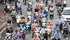 Xe máy sẽ buộc phải dừng hoạt động tại các quận của Hà Nội vào năm 2030. (Ảnh: Doãn Đức/Vietnam+)