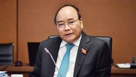 Thủ tướng Nguyễn Xuân Phúc phát biểu thảo luận tại tổ sáng 24/10. Ảnh: HNMO