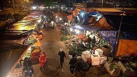 Cảnh sát hình sự Hà Nội đang xác minh nghi án nổ súng cướp tiền ở chợ Long Biên