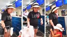 Hành khách Lê Thị Hiền tranh cãi với nhân viên Hàng không. Ảnh: cắt từ clip