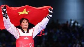 Hà Thị Nguyên vô địch tuyệt đối hạng 62kg. tác giả: PHẠM ĐƯƠNG