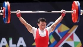 Sáng mai 20-8, lực sĩ Thạch Kim Tuấn sẽ bước vào cuộc chinh phục tấm HCV hạng cân 56kg nam. Ảnh: PHÚC NGUYỄN