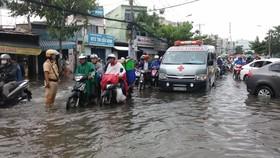 Nhiều khu vực trên địa bàn TPHCM bị ngập nước sau mỗi trận mưa lớn. Ảnh: ĐAN NGUYÊN