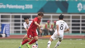 Minh Vương với siêu phẩm trong trận gặp Hàn Quốc tại Asiad 2018. Ảnh: ANH KHOA