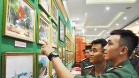 """Triển lãm ảnh """"Lực lượng vũng trang Quân khu 7 – 50 năm thực hiện Di chúc của Chủ tịch Hồ Chí Minh"""""""
