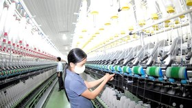Vietnam needs foreign direct investments in fiber, dyeing and raw fabric. (Photo: SGGP)
