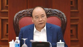PM Nguyen Xuan Phuc at the working session. (Source: VNA)