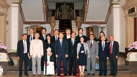 Officials of HCM City and representatives of the International Friendship Exchange Council of Japan pose for a photo (Photo: VNA)