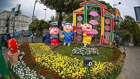 A family of pigs which are chosen as the sacred animals of Nguyen Hue Flower Street 2019