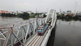 The new Binh Loi Bridge crossing Sai Gon River in HCM City opens to train traffic on September 14. (Photo: VNA/VNS)