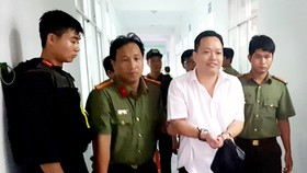 Nguyễn Huỳnh Đạt Nhân, Giám đốc Công ty Tây Nam lúc mới bị bắt. Ảnh: LÊ PHƯƠNG