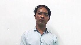 Đối tượng Phan Thành Tấn tại cơ quan công an
