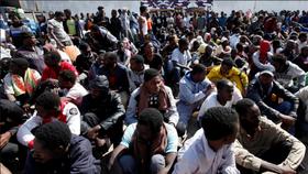 Người di cư châu Phi tại chợ nô lệ ở Tripoli. Ảnh: AL JAZEERA