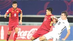 越南(紅衣)對新西蘭比賽一瞥。(圖源:互聯網)