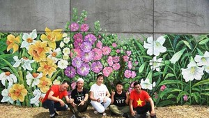 "The large picture titled ""France-Vietnam Spring"" is painted by artist Nguyen Thu Thuy and her colleagues of the New Hanoi Art Company."