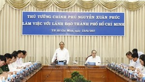 Prime Minister Nguyen Xuan Phuc speaks at a working session with HCM City's key leaders on June 23 (Source: VNA)