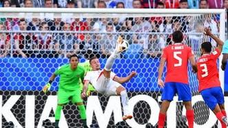 哥斯達黎加與塞爾維亞(白衣)比賽一瞥。