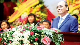 Thủ tướng Nguyễn Xuân Phúc phát biểu tại diễn đàn  Công đoàn Việt Nam đồng hành cùng Chính phủ
