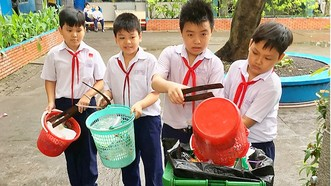 小學生良好執行環境保護工作。(圖源:誠智)