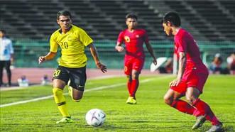 馬來西亞隊(黃衣)與緬甸隊比賽一瞥。