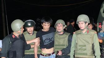 Áp giải đối tượng Nguyễn Thành Trung về cơ quan điều tra