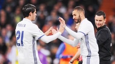 Morata là nạn nhân mới nhất của Benzema (phải).