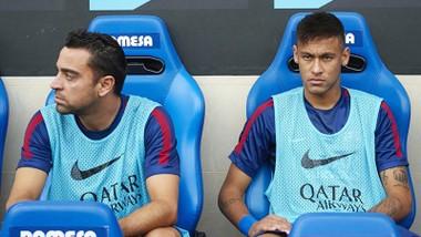 Xavi (trái) là người biết trước kế hoạch rời đi của Neymar. Ảnh: Getty Images