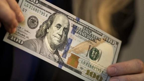 交易 100 美金, 一婦女被罰 4000 萬元。(示意圖源:互聯網)